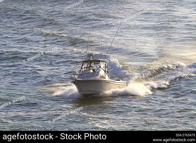 Fishing boat coming into Depoe Bay, Oregon, USA
