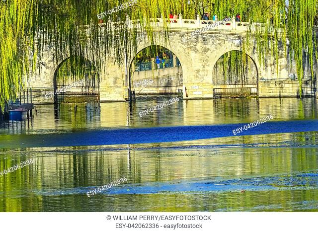 Bridge Green Willows Jade Flower Island Beijing China Beihai public park created 1000 AD