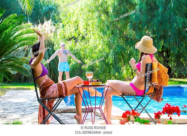 Women poolside enjoying a drink