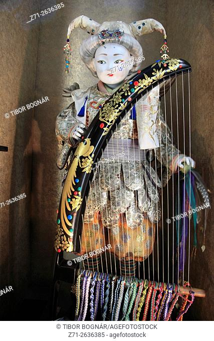 Japan, Tokyo, Ginza, doll with harp, store window,