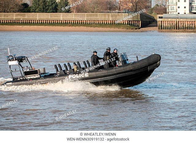 Metropolitan Police, in conjunction with the Royal Navy and Royal Marines, perform joint security exercise ahead of 2012 Olympics, at Woolwich Arsenal Pier
