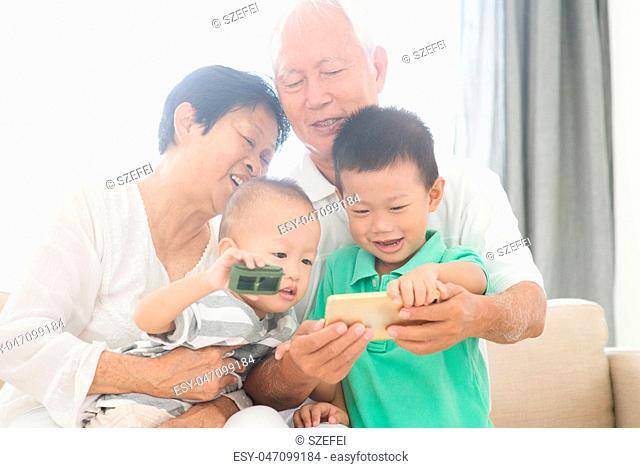 Grandparents and grandchildren selfie with smart phones