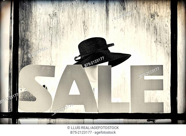Sale, showcase announcing reductions in a hat shop in central London, England, UK, Europe