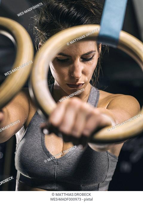 Female athlete, hand on gymnastic ring