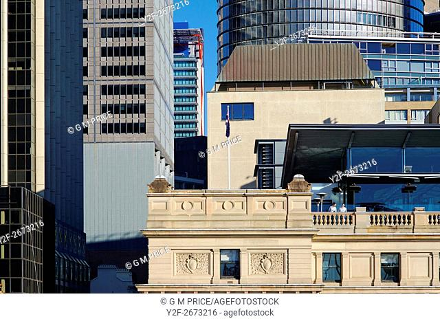 Sydney office buildings from Cahill Expressway with two women on terrace of Customs House