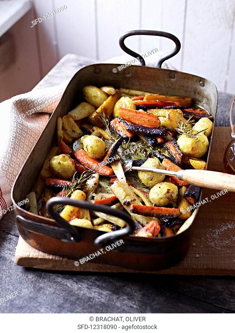 Oven-roasted vegetables in a roasting tin