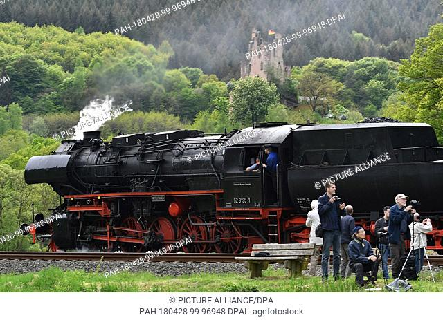 27 April 2018, Germany, Trier: A steam train travelling past photographers on the route from Gerolstein to Trier. From the 28 April to the 01 May 2018