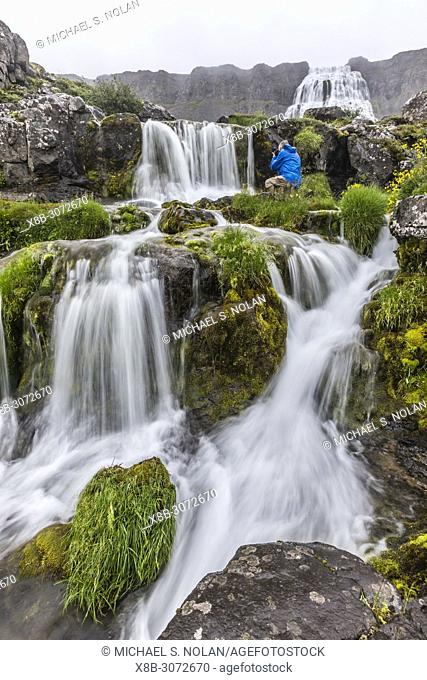 Photographer at Dynjandi, Fjallfoss, a series of waterfalls located in the Westfjords, Iceland