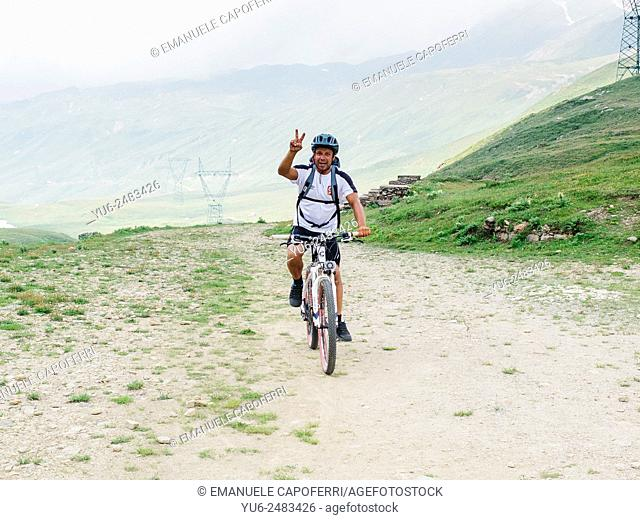 Cyclist during hike in Val Formazza, Piedmont, Italy