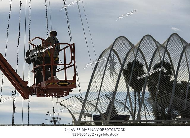 Workers installing the Christmas tree in the city of arts and sciences, Valencia, Spain