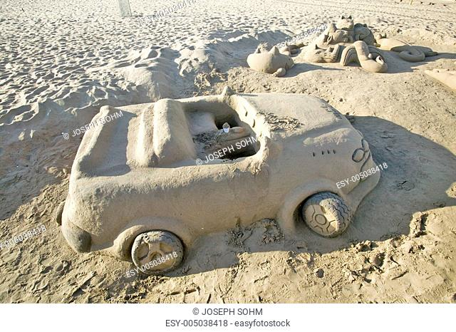 Sand castle of car with cup holder on beach of Durban, South Africa
