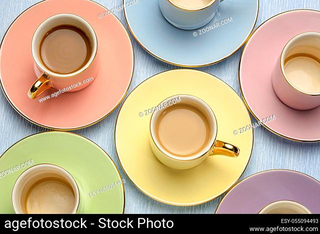 set of pastel porcelain cup with coffee and empty, top view