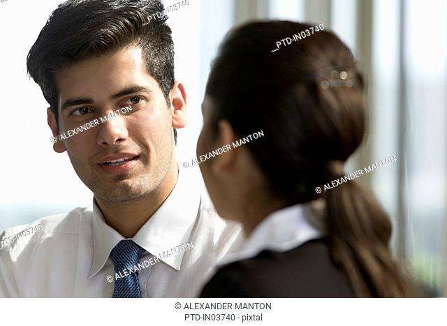 Businessman talking to female colleague