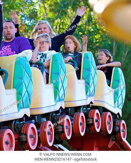 Gwen Stefani takes her three sons to Disneyland Park in Anaheim, California. Gwen looked super glam, wearing a black moto jacket