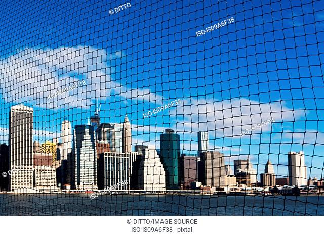 View of Manhattan skyline through netting, New York City, USA