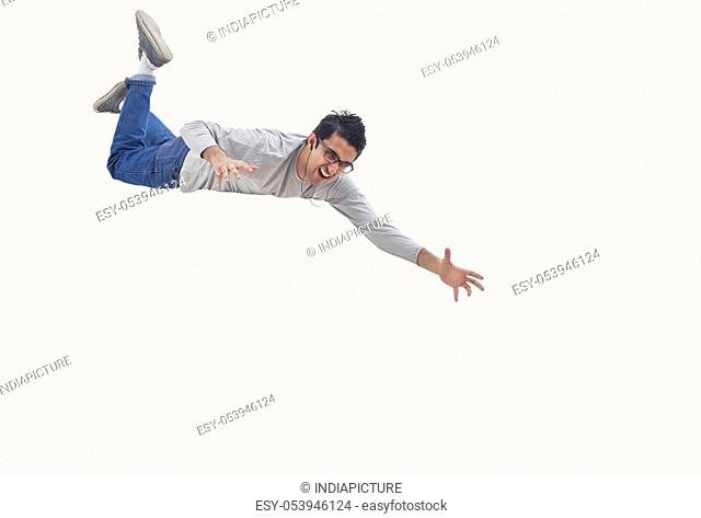 Young man trying to catch