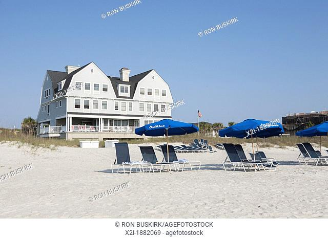 Beach umbrellas line the waterfront at Elizabeth Pointe Lodge resort hotel at Amelia Island, Florida
