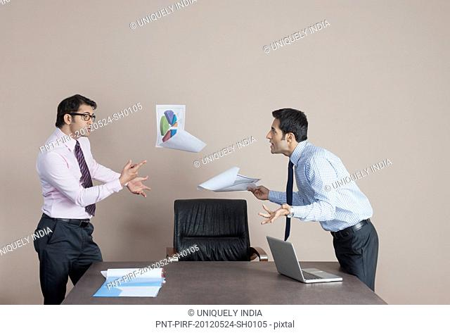 Two businessmen arguing to each other