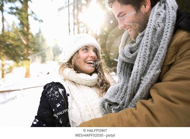 Happy young couple face to face in winter