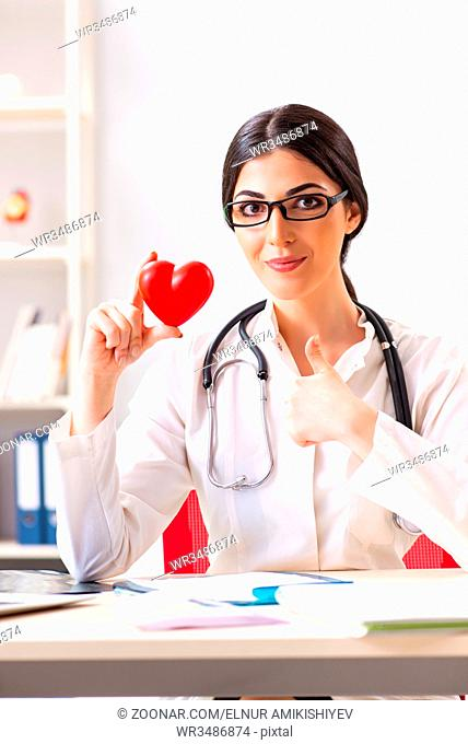 Young doctor in heart care concept