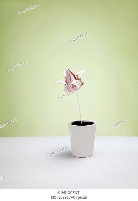 Origami yen banknote in plant pot
