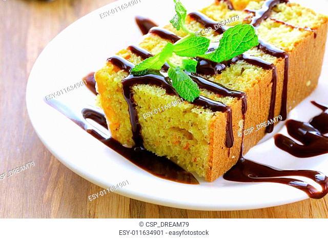 piece of orange cake with chocolate