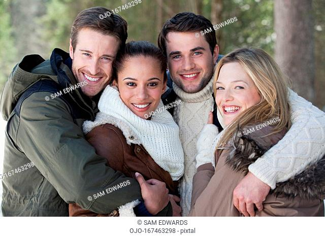 Portrait of smiling couples hugging