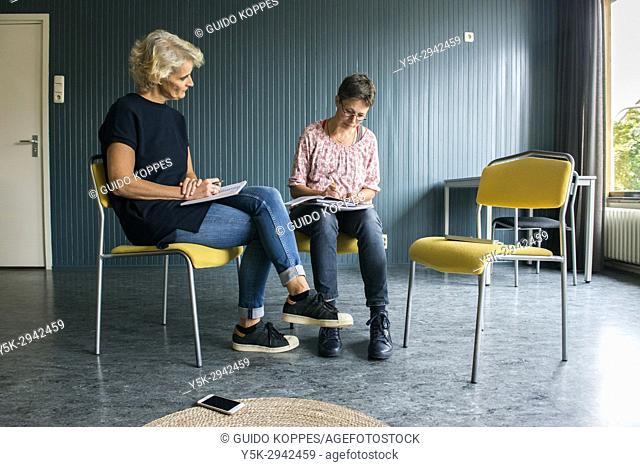 Tilburg, Netherlands. Mature adult woman having a coaching interview while searching for a new job and occupation
