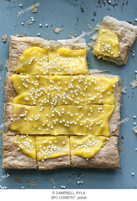 Easter lemon curd puff pastry tart topped with sugar pearls