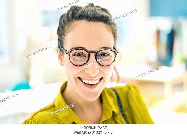 Portrait of happy young woman wearing glasses