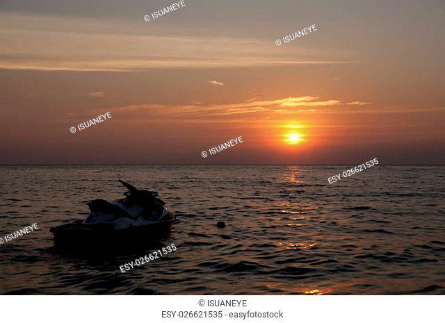Jet ski silhouette in sunset