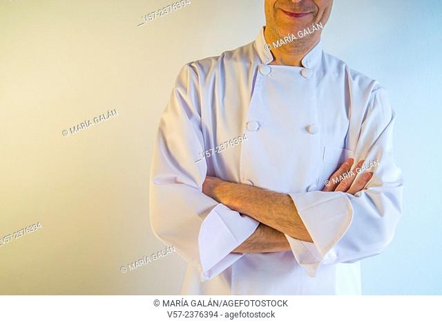Cook smiling, crossing arms