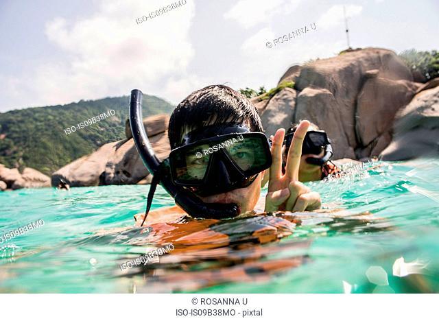 Young man and woman snorkelling, Nangyuan Island, Thailand