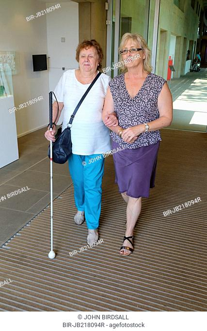 Woman with visual impairments with helper at the Yorkshire Sculpture Park