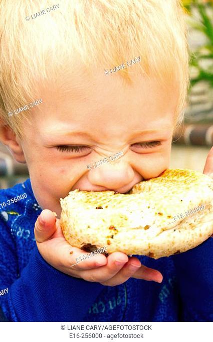 boy eating bagel