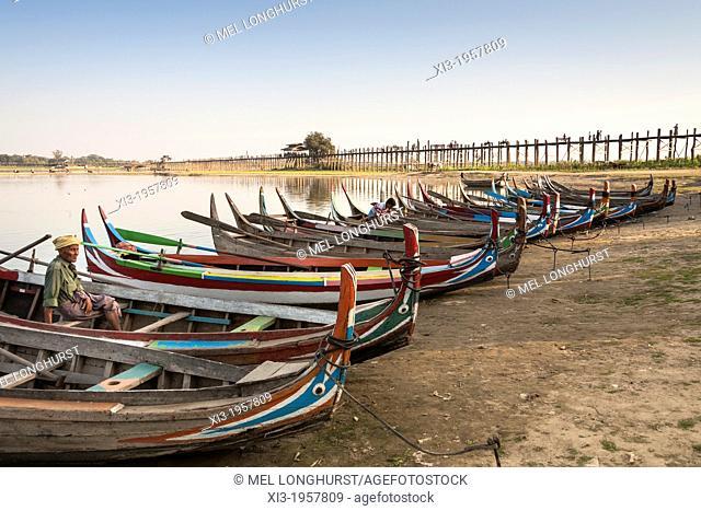 Boats on Taungthaman Lake beside U Bein wooden bridge, Amarapura, Mandalay, Myanmar, (Burma)