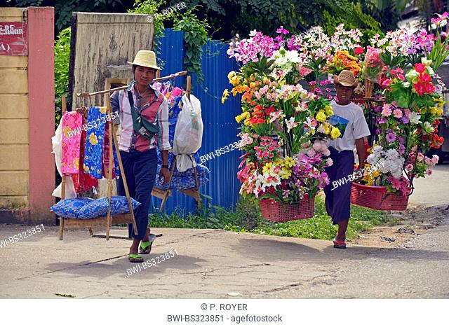 young street vendors selling plastic flowers and fabrics, Burma, Yangon