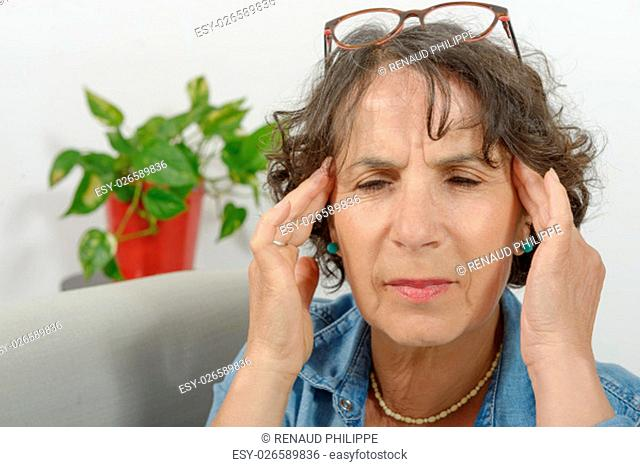 a middle-aged woman has headache