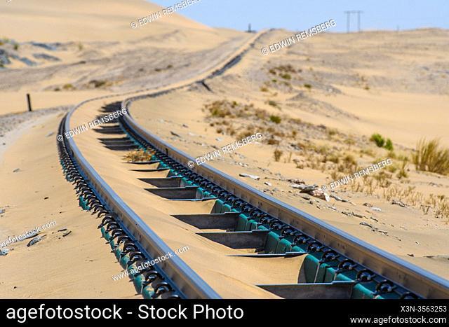 An old railway cutting through the desert , Grasplatz, Namibia