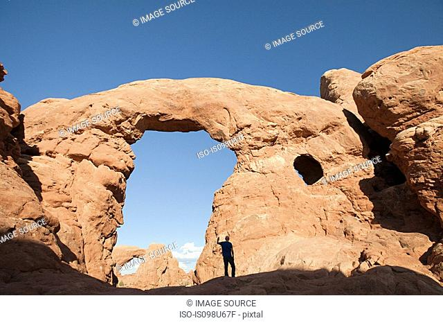 Person standing under Turret Arch, Arches National Park, Moab, Utah, USA