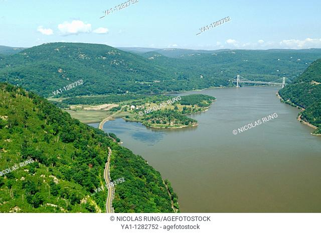 Aerial view of Hudson river, road 9W (down), Iona island (middle) and Bear Mountain state park (back) during summertime, North-West of Peekshill Bay