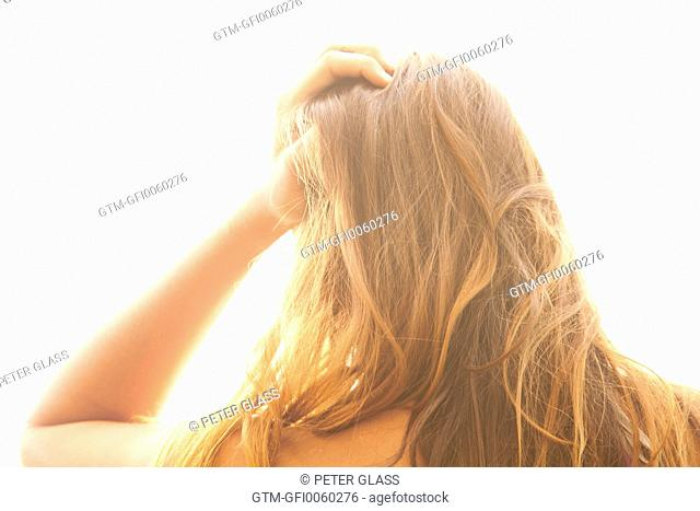 Young woman with her hand on her head