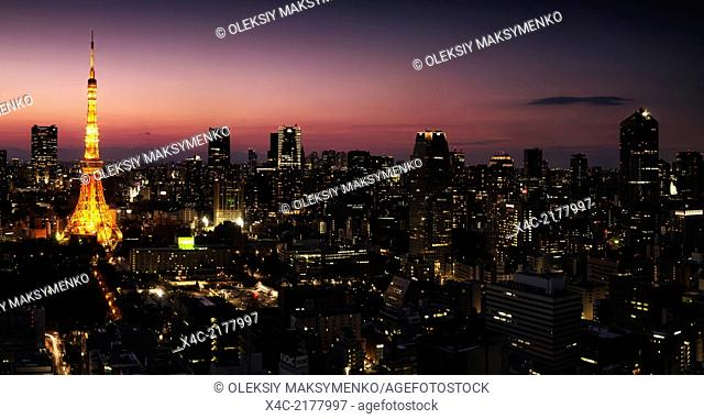 Panoramic city scenery of Minato, Tokyo with brightly lit Tokyo tower at night.Japan