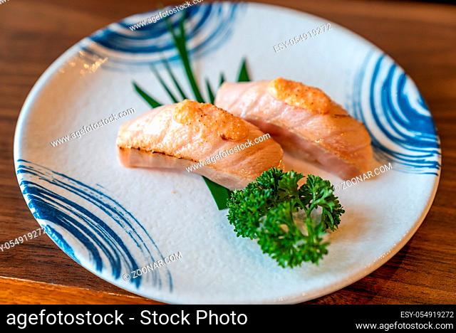 Burn Flaming Salmon Sushi in Traditional Japanese style plate