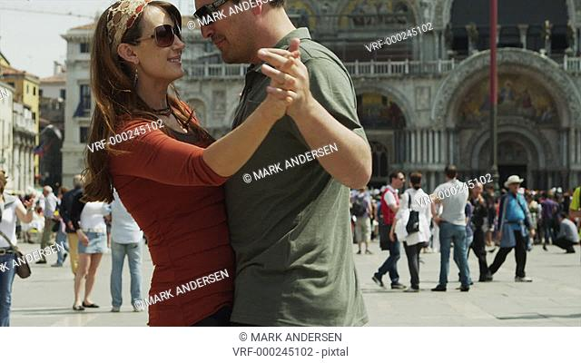 SLO MO MS TU Romantic couple dancing on St. Mark's Square / Venice, Italy