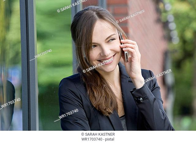 Businesswoman phoning with mobile phone
