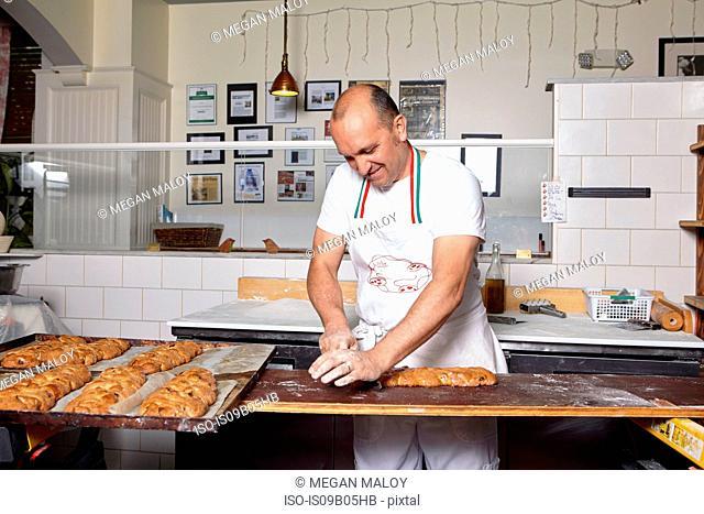Baker working in bakery