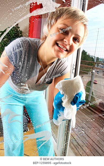Young woman doing the cleaning
