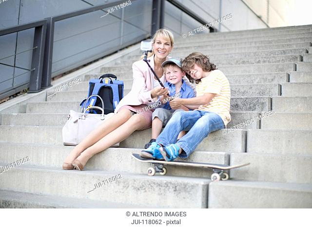 Businesswoman Mother Taking Selfie Outside Office With Sons