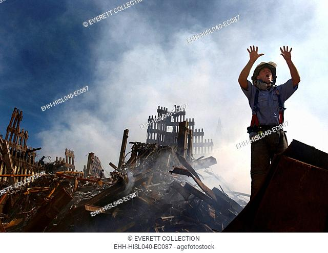 NYC Fireman signals for 10 more rescue workers to come into the rubble of the Ground Zero. Sept. 15, 2001. World Trade Center, New York City, after September 11